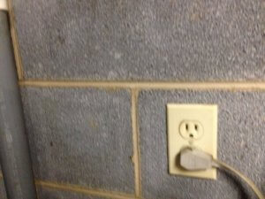 Electric socket on the wall in the basement
