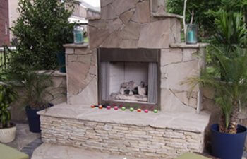 Patio with a stone fireplace