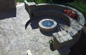 Stone patio with a fireplace