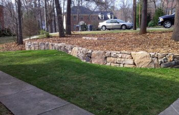 Stone retaining wall in the garden