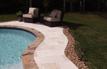 Stone patio by the pool in the garden